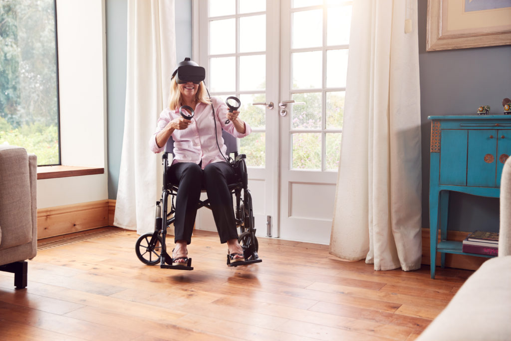 woman in wheelchair using virtual reality headset